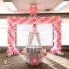 Sân khấu sinh nhật thôi nôi hồng và trắng SK059