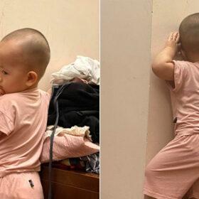 Bị bố phạt úp mặt vào tường, biểu cảm của bé Cốm, con chị Văn Thùy Dương lộ rõ vẻ hài hước